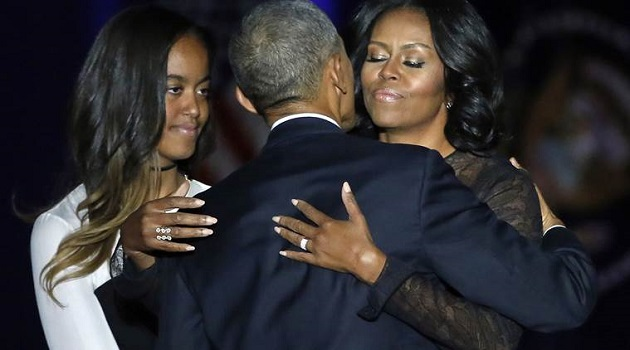 President Barack Obama is joined by his First Lady Michelle Obama and his daughter Malia after giving his presidential farewell address at McCormick Place in Chicago, Tuesday, Jan. 10, 2017. (AP Photo/Charles Rex Arbogast)